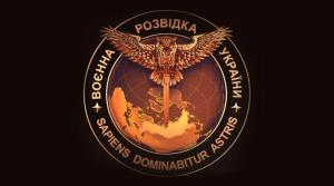 "Symbol of the Ukrainian military intelligence adopted in November 2016: an owl carrying a sword over Eurasia. Top phrase in Ukrainian says ""Military Intelligence of Ukraine."" Bottom phrase in Latin means ""The wise man will master the stars."""