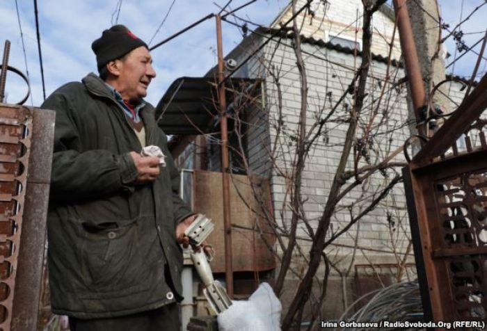 Uncle Vasya shows artillery fragments