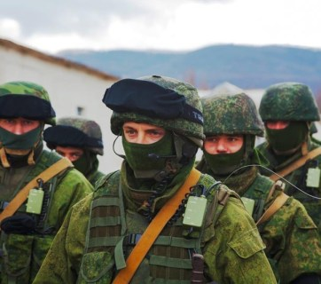 Masked Russian servicemen blockading a Ukrainian military base in Crimea. March 2014