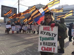 """A Russian nationalist protester holding a sign: """"No To Cult of Trump In Our Mass Media."""" February 2017 (Image: @_Borodulin)"""