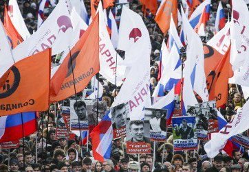 Approximately 15,000 people took part in demonstrations in Moscow, Russia marking two years since opposition leader Boris Nemtsov was gunned down near the Kremlin walls (Image: newstalk.com)