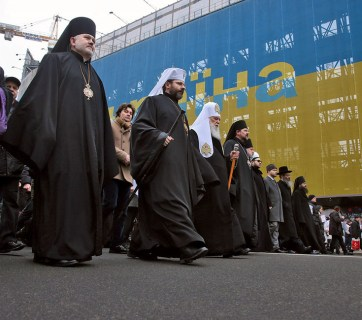 Patriarch of Kyiv and All Rus'-Ukraine Filaret (forth from left) marching among leaders of Ukraine's other religious denominations. Filaret has been the head of the Ukrainian Orthodox Church of the Kyivan Patriarchate since 1995. Until 1992 he was a Metropolitan bishop of the Russian Orthodox Church. Moscow Patriarchate excommunicated him in 1997. (Image: Ivan Kovalenko / Kommersant)