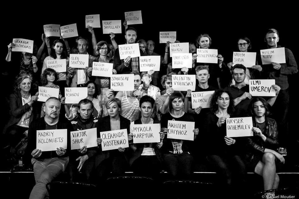 Belarus Free Theater participants stand with the names of the Kremlin's Ukrainian hostages