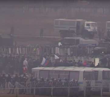 Putin's Russian Guard exercises to suppress mass protests (Image: screen capture of Open Russia video)
