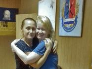 Liudmyla Surzhenko (right) and civil volunteer Kateryna Artemenko embracing each other as Liudmyla released