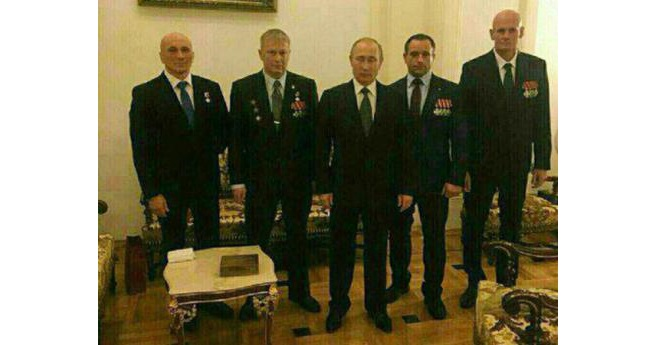 "Russian president Vladimir Putin pictured with Dmitry Utkin (""Wagner"") on the far right and other commanders of the Wagner private military company that fights on orders of the Russian military in Ukraine and Syria, but is not a part of it formally. This image is believed to date from December 2016."