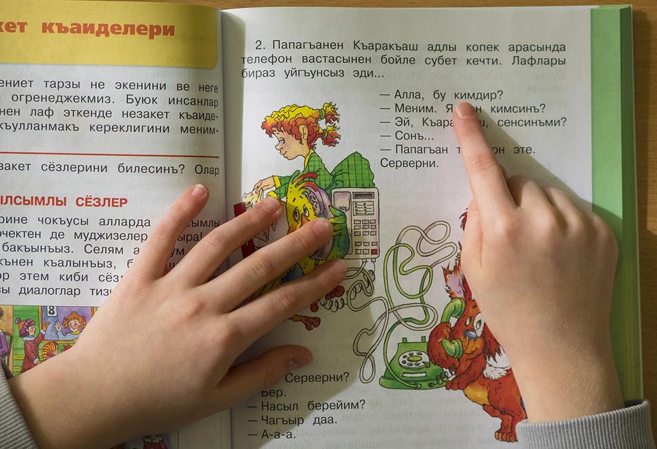 A Crimean Tatar language textbook (Image: TASS)