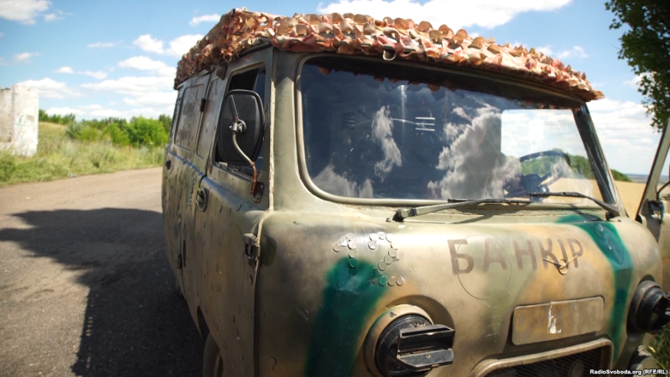 "The UAZ-452 Bukhanka – the ""Bread-Loaf"" – patched up for service with the Kyiv Battalion. If you look closely, you can see coins in the shape of a ""12"" over the left headlight."