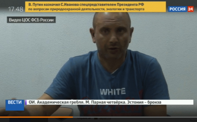 "Andriy Zakhtey's televised ""confession."" Screenshot from video"