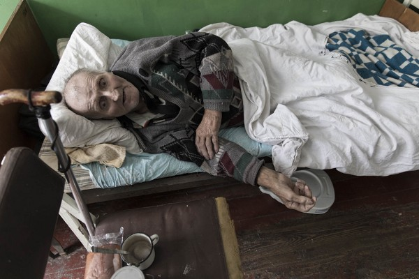 An elderly man remains in a retirement home without care from family.