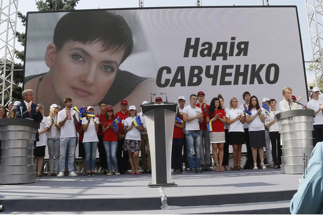Nadiya Savchenko became part of Batkivshchyna's electoral campaign. Here, party leader Yuliya Tymoshenko is seen speaking in front of a billboard showing Nadiy Savchenko