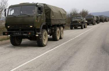 Russian military convoy without license plates or any marking on its way from the East-Crimean city of Feodosiya to the regional capital of Simferopol. March 2014. Photograph: independent.co.uk