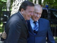"""Vladimir Putin with Gerhard Schröder, former Chancellor of Germany (1988-2005) who became top GAZPROM representative and lobbyist of Putin's interests in the country after leaving his government position. The term """"shroederization"""" now stands for the corruption of Western elites by the Putin regime."""