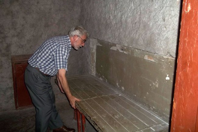 Deputy Director of Prison on Lontskoho Ihor Ozhyyivsky shows prison bunk beds