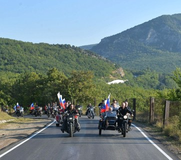 Vladimir Putin riding a three-wheel motorcycle carrying the top two officials of the Russian occupation administration for Crimea Sergey Aksyonov and Mikhail Razvozhayev and being escorted by members of Moscow's Night Wolves biker club. Crimea, August 10, 2019. Photo: kremlin.ru