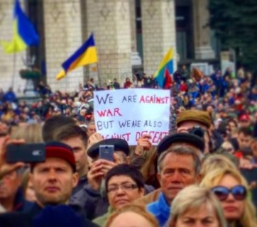 """We are against war, but we are also against defeat,"" reads the placard held by a participant of the ""Let's Stop Capitulation"" rally in Kyiv on 6 October 2019. Photo: Dmytro Karpiy/Facebook"