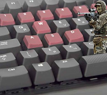 Hybrid war (computer keyboard and Russian soldier)