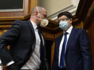 Prime Minister Denys Shmygal and Head of Parliament Dmytro Razumkov talking before the voting. They and all people's deputies came to the Parliament in masks due to corona virus.