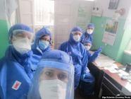 Ukrainian doctor Olha Kobevko with colleagues involved in fighting COVID-19. Photo via RFE/RL