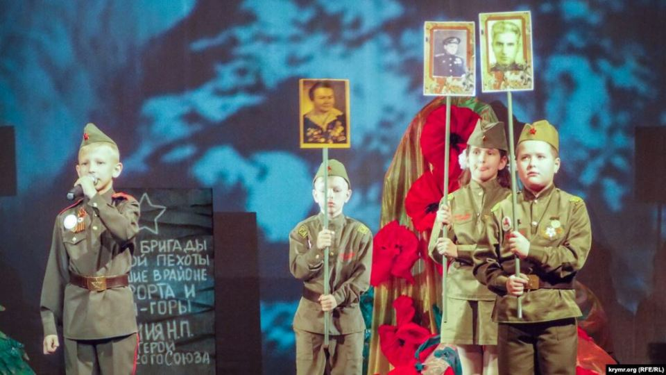 """Children performing in an official Victory Day ceremony, """"We Are the Heirs of the Victory,"""" organized by the occupation administration in Sevastopol in Russian-occupied Crimea, April 19, 2020. Photo: Krymr.org (RFE/RL)"""