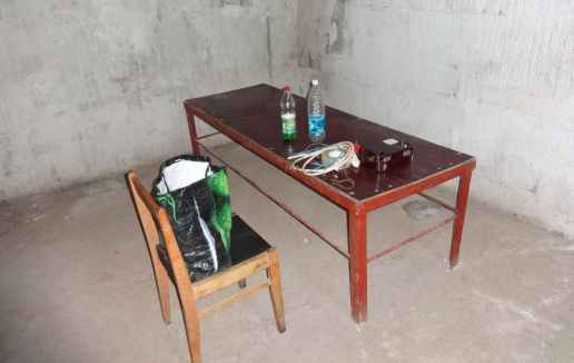 Torture chamber for Izolyatsia prisoners with a military field telephone's electric generator used to electrocute them. Photo: Telegram/traktorist_dn