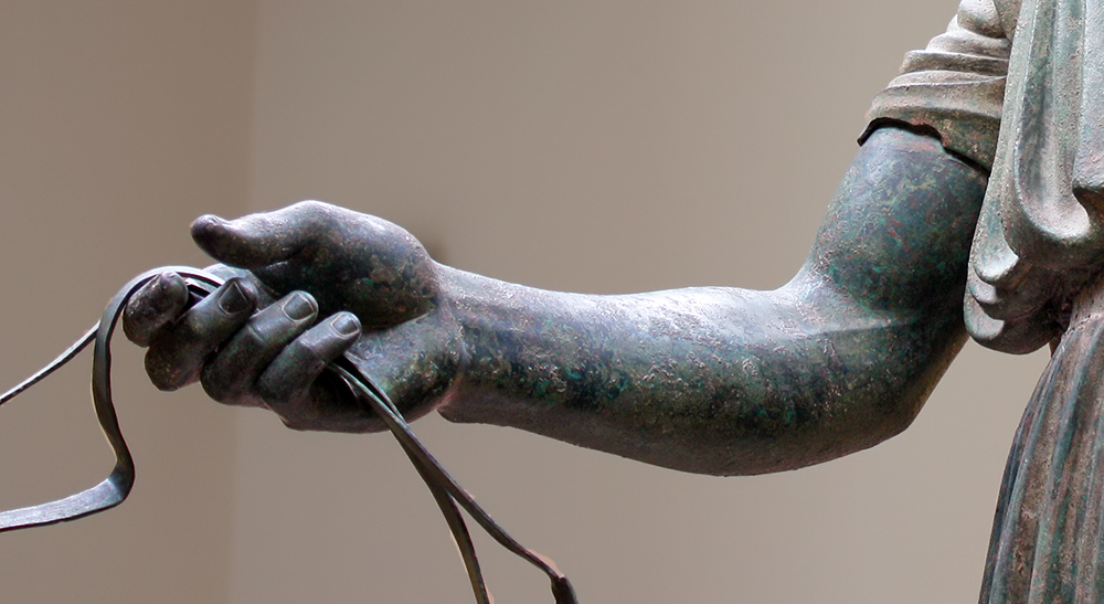 The charioteer of Delphi. The arm and reins