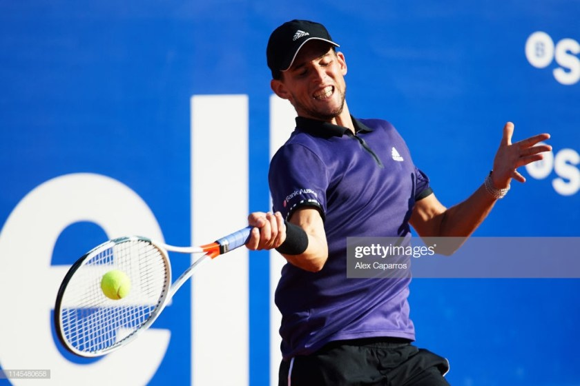 BARCELONA, SPAIN - APRIL 27: Dominic Thiem of Austria plays a forehand against Rafael Nadal of Spain during their semifinal match during day six of the Barcelona Open Banc Sabadell at Real Club De Tenis Barcelona on April 27, 2019 in Barcelona, Spain. (Photo by Alex Caparros/Getty Images)