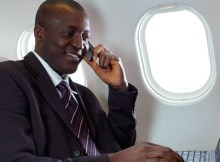 A passenger uses his mobile phone during flight