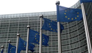 Flags in front of the Berlaymont building - headquarter of the European Commission