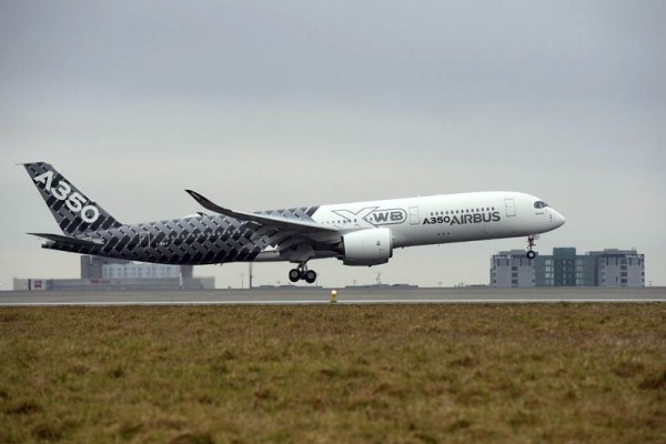 """The Airbus A350 XWB jetliner made its """"premiere"""" in Paris on 26 February 2015, landing for the first time at Paris Charles de Gaulle airport (© Airbus)"""