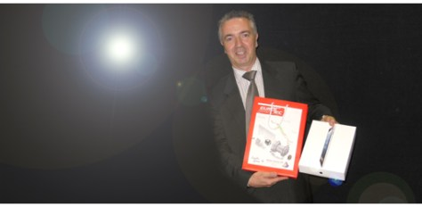 And the winner amongst our advertisers for 2013 is Sarix; M. Frank Leleu, marketing and sales manager showing the iPad he had just won!