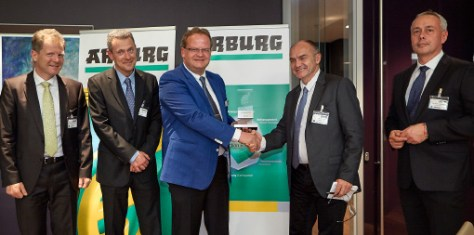 Smiling faces upon receipt of the Arburg Energy Efficiency Award 2015: The high-ranking ARaymond representatives Jürgen Trefzer, François Raymond (from left), Dominique Roullet-Revol and Tomas Cerman (from right), along with the Arburg Managing Partner Michael Hehl (center).