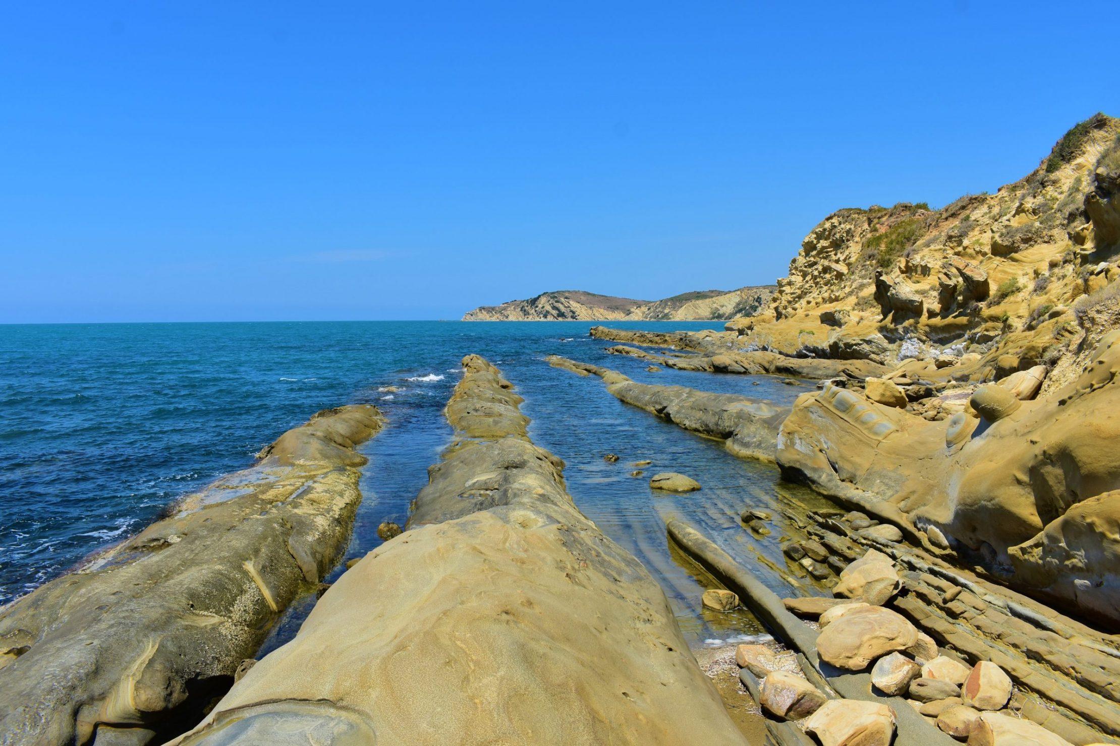 Albania - best places - Unusual stripes of limestone in a beach in Narta Lagoon