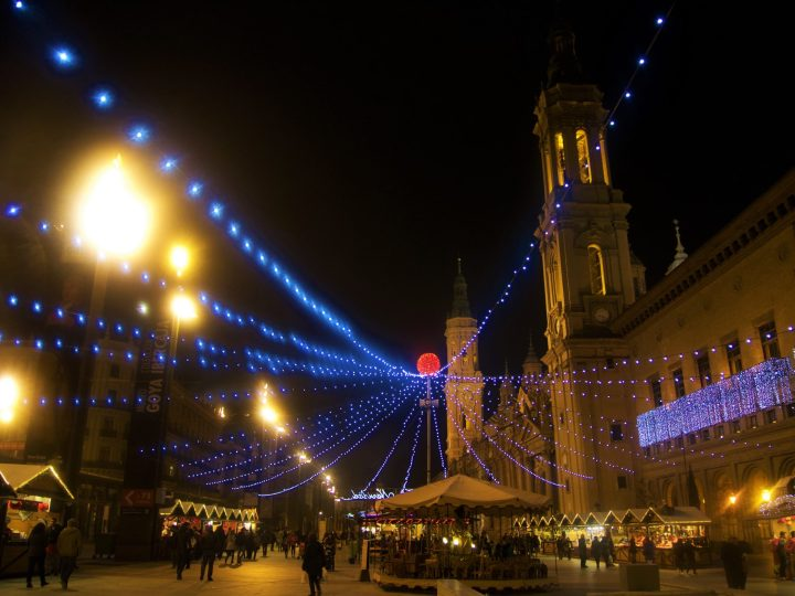 Christmas market in Zaragoza, Spain, with the background on the wonderful Pilar Square