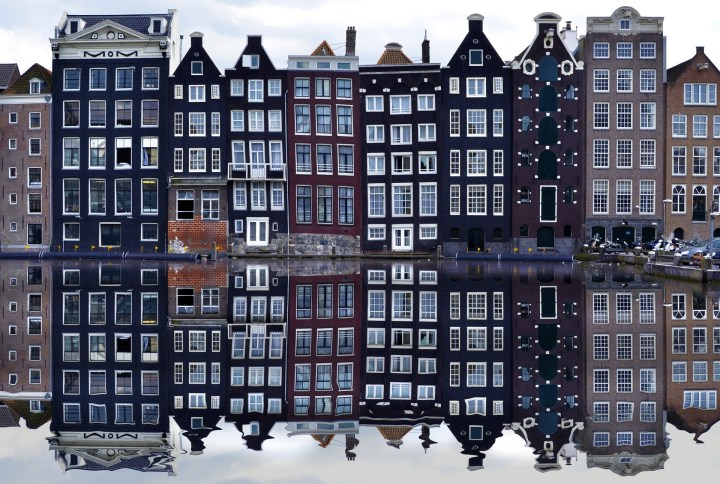 Characteristic brown crooked canal houses of Amsterdam