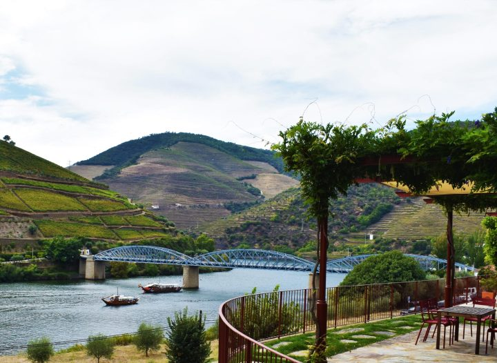 Scenic boat trip along the Douro River on board of a traditional 'rabelo' boat used to transport wine barrels