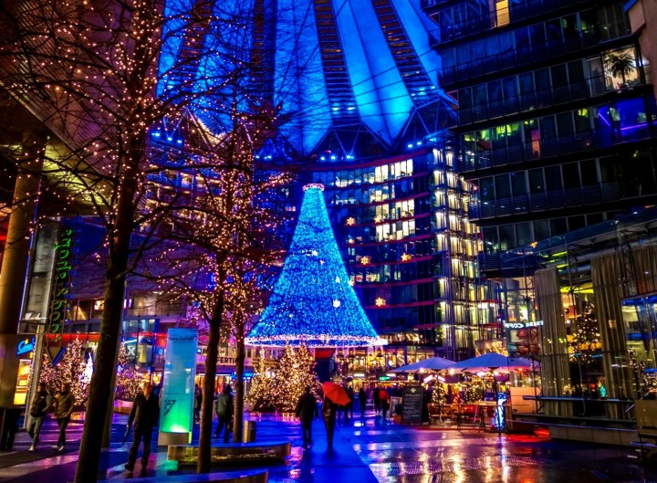 Christmas market in the vivid lights of the Sony Centre in Potsdamer Platz in Berlin, Germany