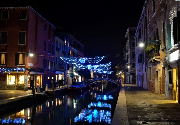 Venetian canals illuminated by Christmas lights