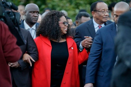 "Oprah Winfrey locks arms with some of the cast of the new movie ""Selma"" as they march to the Edmund Pettus Bridge in honor of Martin Luther King Jr., Sunday, Jan. 18, 2015, in Selma, Ala."
