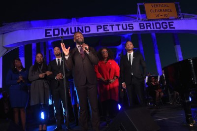 (L-R) Congresswoman Terri Sewell, Ava DuVernay, Common, David Oyelowo, Oprah Winfrey, and John Legend address the audience at a special performance on January 18, 2015 in Selma, Alabama