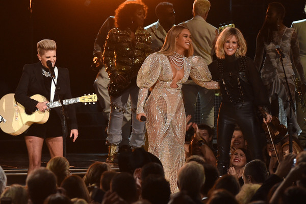 Beyonce performs onstage with Martie Maguire of Dixie Chicks at the 50th annual CMA Awards at the Bridgestone Arena on November 2, 2016 in Nashville, Tennessee.