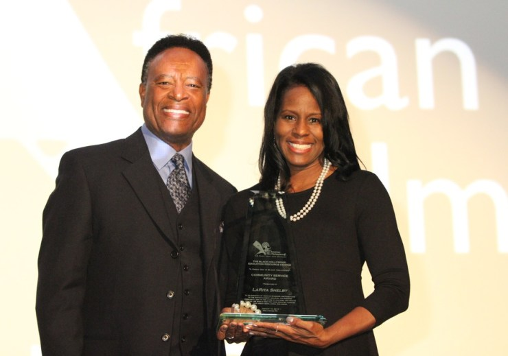 BHERC master of ceremonies William Allen Young congratulates BHERC's Community Service Award winner 2016 LaRita Shelby (EURweb & star of urban classic South Central). The 2017 gala is Jan 14th at the Harmony Gold Theatre. For info go to BHERC.org.