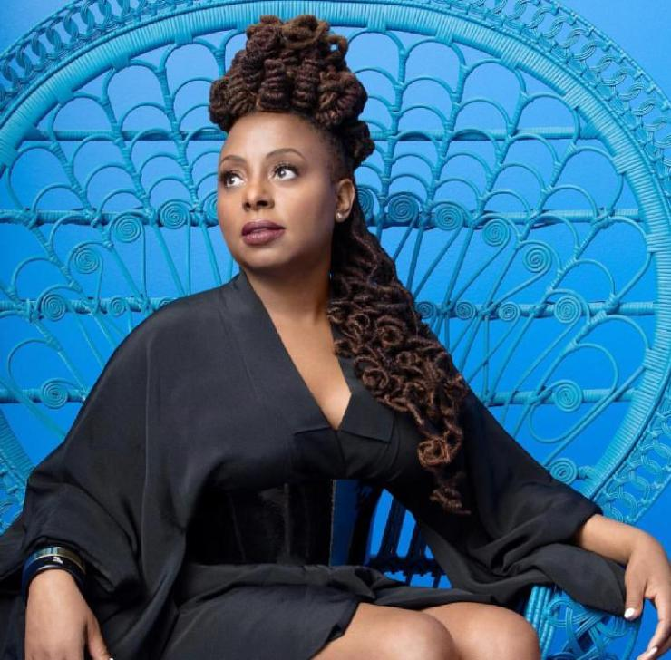 Ledisi seated-in-black-and-blue-photo-by-ron-t-young