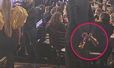 Beyonce - Julius bodyguard with champagne bottles