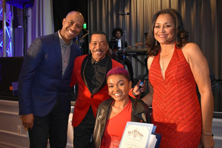 "Lady In Red Diamond Rose Awardee Lauren ""Lolo"" Spencer is congratulated by Corey Turner, host Obba Babatunde and MIMPA Pres. Gail Gibson"