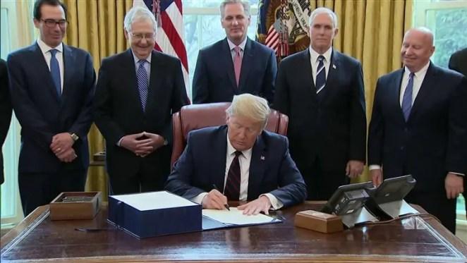 trump signing stimulus bill
