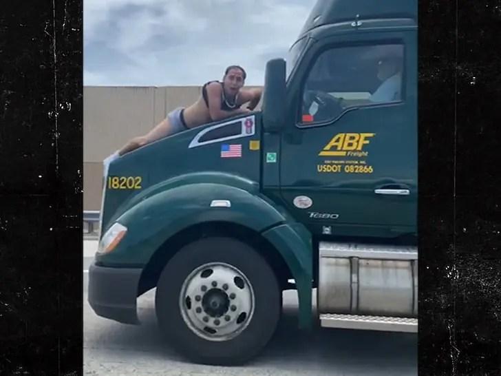 Man on truck hood
