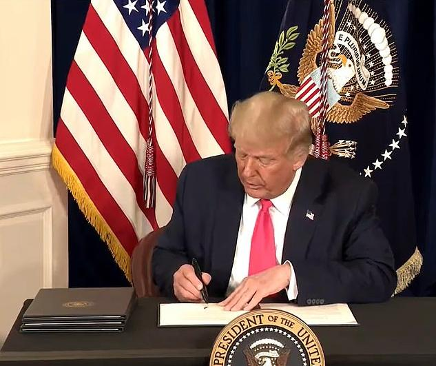 Trump_is_seen_signing_the_first_of_his_four_executive_orders_as_-m-16_1596920372873