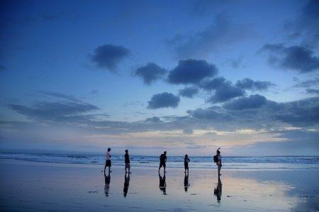 5 people on a beach sun set