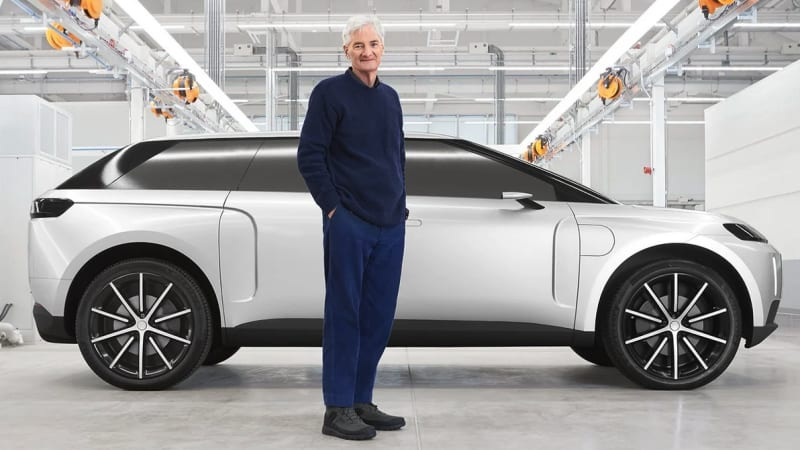 Sir James Dyson standing in front of his car.